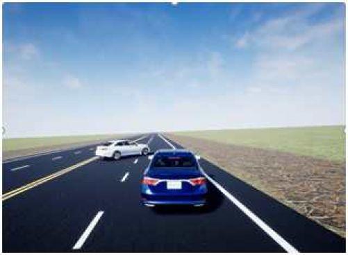 Pohled na souběžnou jízdu stříbrného SUV a modrého sedanu se stejným pohonem, obě vozidla jsou simulována na suché silnici. (Zdroj Eaton)